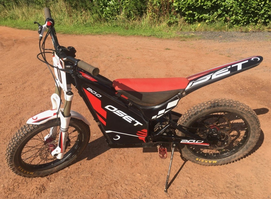 Black and red OSET 20 Eco children's electric trial bike