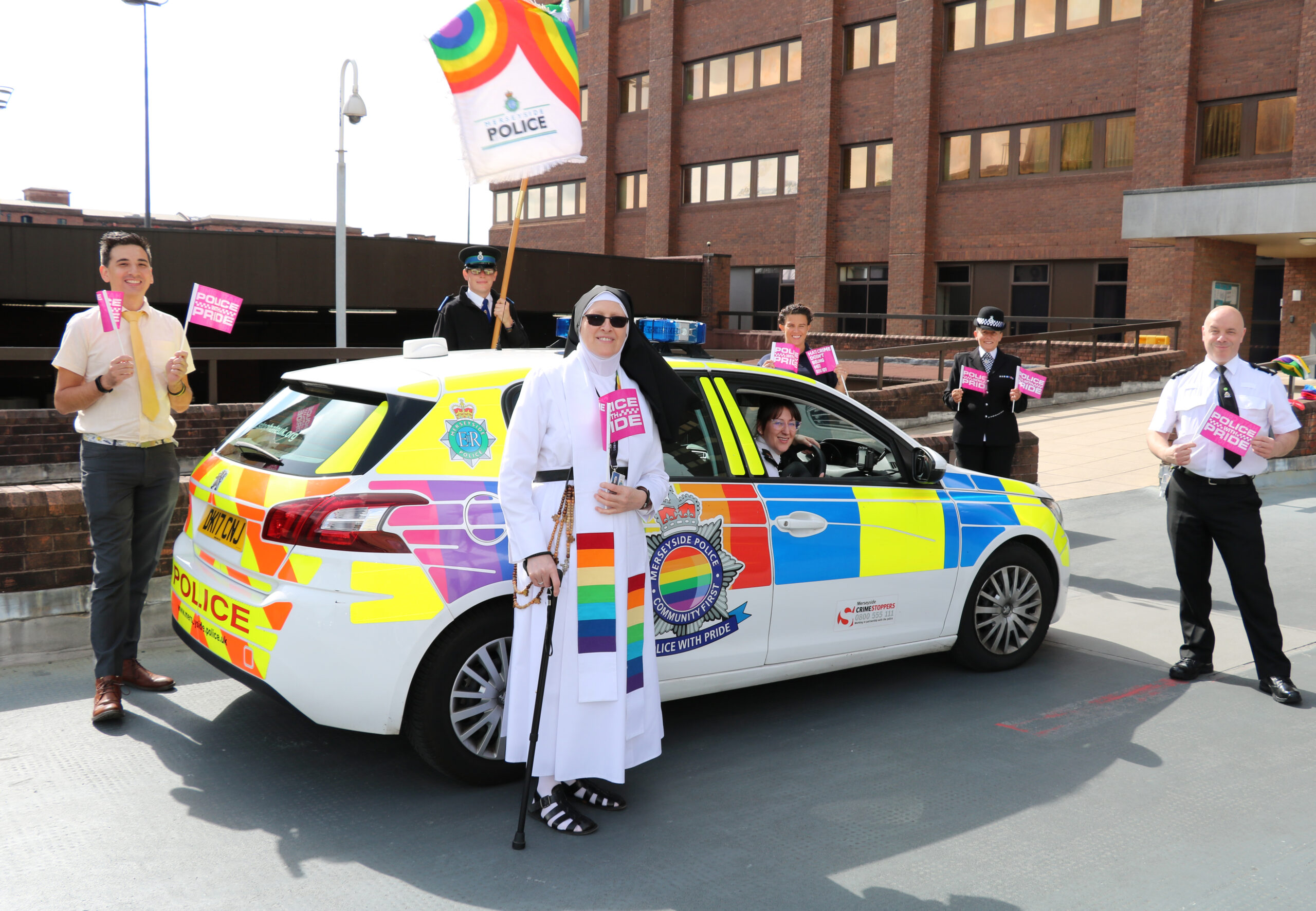 Pride Car with group and Flags.jpg